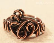Abstract copper loop ring